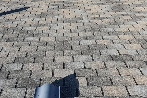 shingles placed on a roof to illustrate why shingles may need to be replaced so please call silver spring roofing contractors today