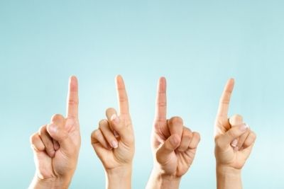 10 questions to ask your roofer in maryland, represented by four hands pointing up against a blue background